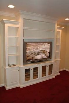 built in bookcase for wide screen TV- We need to build one on our big empty wall