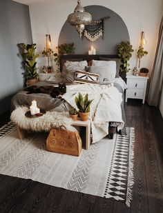 I love this bedroom with all of its bohemian accents! So inviting, especially the little black kitty on the bed!