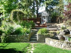 Love the retraining walls.  Playhouse in 15 Family-Friendly Backyard Designs from HGTV