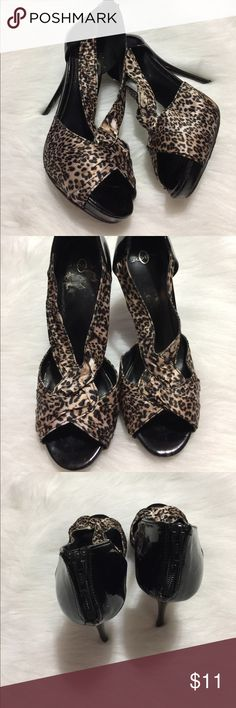 5 inch Joey cheetah print heels Open toe black heels with cheetah faux satin material. Back zipper.  One inch hidden front platform. Minor inside sole peeling and few scuffs. Joey Shoes Heels