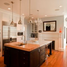 Transitional Glam Kitchen - traditional - kitchen - chicago - Normandy Remodeling  white cabinets & black island