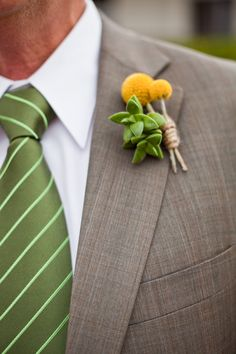 Grey suit with green tie. I love the boutonniere - sweet masculine boutonniere, crespedia and succuluents