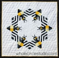 """This """"Bzzzzzz Quilt"""" by Sheri Cifaldi-Morrill of Whole Circle Studio knocks my socks off!!! To say I love it would be an understatement! Paper-pieced pattern for purchase for $12 here: http://www.craftsy.com/pattern/quilting/home-decor/bzzzzzz-bee-mini-quilt/189204"""