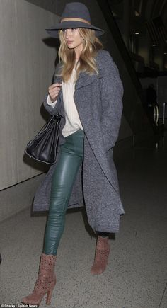 It's all in the bag: Rosie rounded out her ensemble with a large black leather handbag