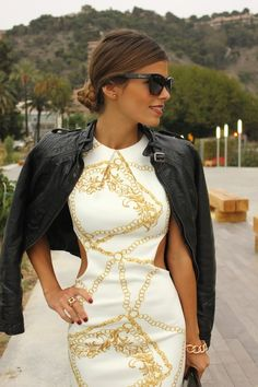 Loving cutout dresses right now. And this is accessorized to perfection.