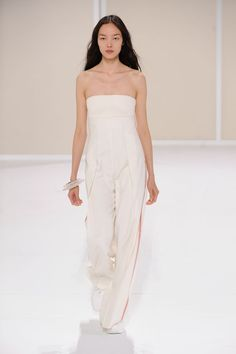 One-piece jumpsuit in off-white panama silk with jasper red stripes, restitched bustier in off-white double-faced cotton and silk #Hermes #HermesFemme #WomensWear #Fashion
