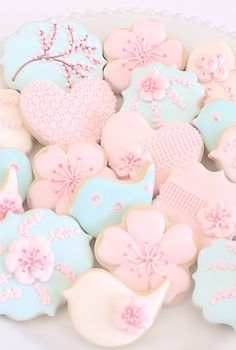 Pastel icing on pretty biscuits - invite friends over for afternoon tea.