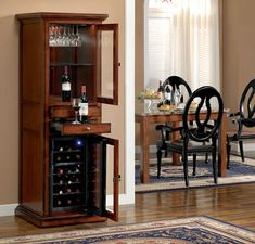 The Meridian has a distinctive upper cabinet which features stainless steel stemware racks and a display area backed by a full length mirror, and the cabinet is lit by hidden three level touch lighting. The lower cabinet stores up to 18 bottles in dual zones, and locks shut to safeguard your wine collection. A solid granite cutting surface and decorative hardware complete this charming wine cabinet.