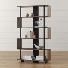 Organize your books with a bookcase from Crate and Barrel. Shop a variety of styles including metal, glass and wood bookcases. Order a book case online.