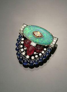 Art Déco Platinum, Opal Doublet, Diamond, Blue Sapphire and Rubies Cip, circa 1939 - Sale 1337 - Lot 91 - WESCHLER'S AUCTIONEERS & APPRAISERS, LLC