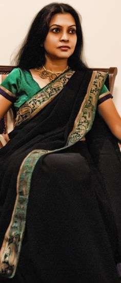 Black georgette sari with border salvaged from antique Benares sari, silk dupioni blouse and antique jewelry - 2007