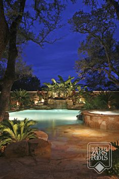Swimming pool with beach entry, waterfall and spa. A true backyard oasis in San Antonio, Texas | Keith Zars Pools