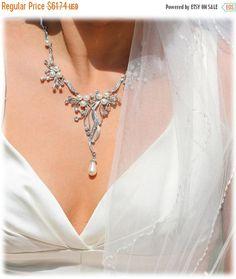 A personal favorite from my Etsy shop https://www.etsy.com/listing/152065214/bridal-jewelry-bridal-back-drop-bib