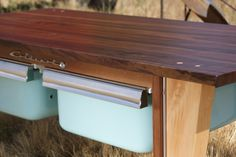 Waterdrop Workshop creates furniture using locally salvaged wood and recycled material out in Walla Walla, Washington. This is a coffee table made from locally salvaged walnut and maple wood, along with two vintage refrigerator drawers underneath for storage