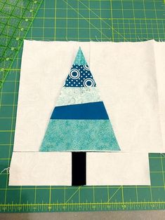 Dive into your fabric stash and whip up a festive scrappy Christmas tree quilt block to use in a holiday quilt, pillow or handmade gift! Christmas Tree Quilt Block, Fabric Christmas Trees, Christmas Quilt Patterns, Cute Christmas Tree, Modern Christmas, Christmas Crafts, Christmas Quilting, Purple Christmas, Coastal Christmas