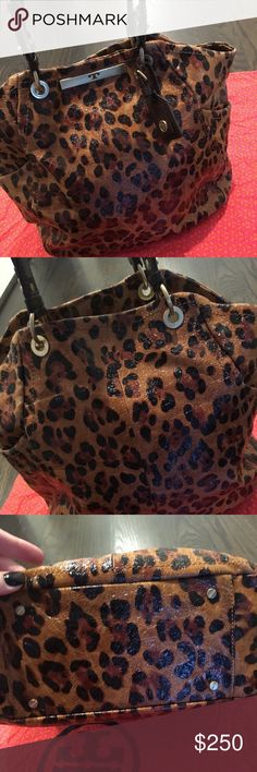 Tory Burch Leather Leopard Print Tote Such a great bag! Dress it up or down. Beautiful animal print leather. 3 Interior pockets, magnetic closure, detachable mirror. Gently worn, comes w original dust bag for storing. Tory Burch Bags Totes