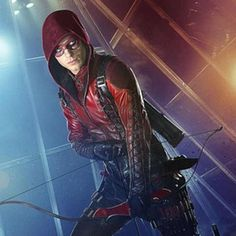 Green Arrow's first sidekick Speedy, and later Arsenal, and then Red Arrow, Roy Harper has grown to become one of the most accomplished marksmen and heroes in the DC Universe. Roy now goes by the name Arsenal once more. Arrow Cw, Team Arrow, Green Arrow Sidekicks, Arsenal Arrow, Roy And Thea, Crossover Episodes, Arrow Drawing, Roy Harper, Colton Haynes