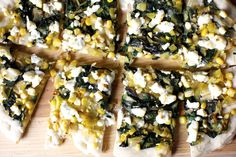 Leeks and corn find harmony against crumbled goat cheese in the most summery thing you could do to a pizza dough.