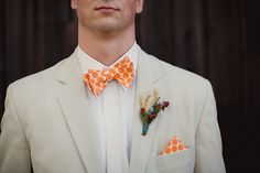 Orange and Teal Wedding with Bowties and a Chartiable Donation