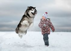 Photographer captures relationship between little kids and their big canine friends.
