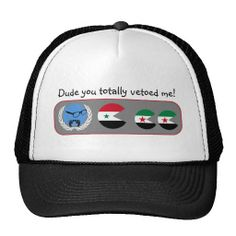 """Syria. Dude you totally vetoed me! Hat """" This design is a satirical look at the United nations in Syria. A video game style image showing the U.N. character sitting, with his feet up, on his laurels. An icon in the colours of the red-white-black United Arab Republic flag, used by Bashar al-Assad and the Ba'ath Party is chasing smaller icons. These are in the colours used by the Syrian Interim Government. The customisable text reads """"Dude, you totally vetoed me!"""" Created By Pollylitical"""