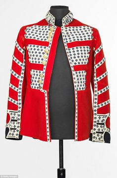 Mick Jagger's red Grenadier Guards drummer jacket was made by Moss Brothers in London. He wore it for an appearance on the iconic British TV show, Ready Steady Go! on 27 May 1966 when the band played, Paint It Black