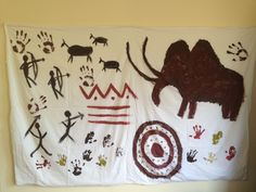 Cave paintings to decorate the walls. I would get a big roll of butcher paper and tape that to the walls.