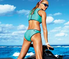 You're set to jet in this two-piece made of wet suit material. Like a sports bra, it holds you in place as you bump over waves - Satisfy Your Active-Girl Appetite With This Sporty Swimwear #SELFmagazine