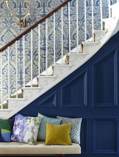 Under stairs paneling in bright or dark hue. Also like the stained handrail on top of the white spindles.