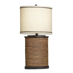 Add rich, transitional style to your bedroom, office or living area with this decorative table lamp. Featuring a natural rope base, this textured one-light fixture is completed by a beige fabric shade with brown stripe accents.