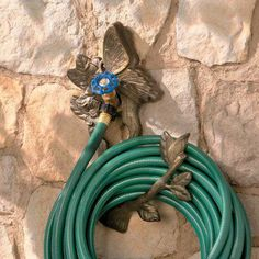 Butterfly Spigot Garden Hose Holder – Just slide the beautiful cast iron hanger over your spigot and roll up your garden hose – now your hose is off the ground and out of the way!