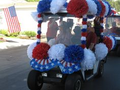4th of July Golf Cart Parade decorated with Tissue Paper Pom Poms