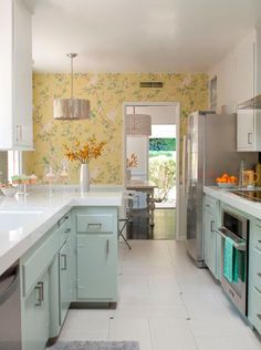 Contemporary Kitchen with Super White Quartz, Worlds Away Faceted Chandelier, interior wallpaper, limestone tile floors