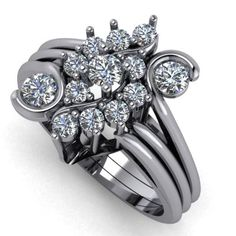 This is what can happen when you have a lot of loose stones... we create a spectacular cluster ring! 14k White Gold diamond cluster custom ring by Robinson Jewelers.