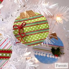 Turn this year's gift wrap scraps into pretty paper ornaments for next year's tree. Trace a can onto a piece of wrapping paper, cut it out and embellish with recycled ribbon.