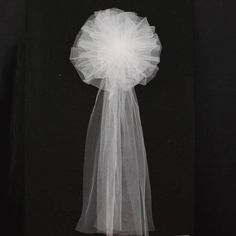 White Tulle Wedding Pew Bows. We want to add a mint green flower in the center with mint green satin ribbon streamers.