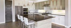 Modern Kitchen with Slate counters, Kitchen island, Breakfast bar, European Cabinets, Hardwood floors, Glass panel, Flush