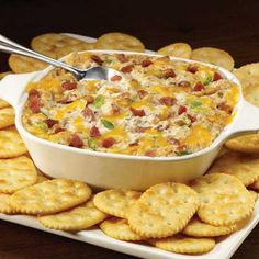 Excite your guests with a cheesy, baked dip that goes perfectly with crackers!