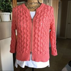 "❤️Sale❤️Chico's Loose Weave Sweater Size XS Beautiful sweater from Chico's. I may have worn it once. It's a beautiful rose color and features a double zipper and 3/4 sleeves. Great for layering. The bust measures approx 38"" and the length measures approx 22"". 100% Cotton. Hand wash, Lay flat to dry. This is a Chico's size 0 which is their version of XS or size 4/6. Their clothes run large in my opinion and this could fit a larger size. Chico's Sweaters Cardigans"