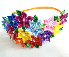 A flower is made in the technique of tsumami kanzashi. A metal headband is weaved with satin ribbon. Flower is made from Satin ribbons. DMC crystals.  My handworks can be a unique gift for you, your family and friends!  For more items, please visit my shop home: