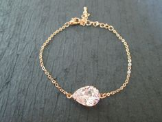 Listing is for Bracelet only.  Handcrafted Crystal Bracelet featuring 14x10 mm Swarovski Crystal Pear Shaped Stone set in a Rose Gold Plated Frame and