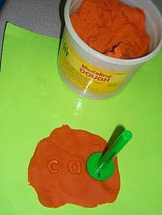 Word Work - Dough Stampers *could use alphabet magnets if you dont have the stamps!*