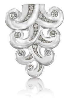 JEWELS FROM THE PERSONAL COLLECTION OF SUZANNE BELPERRON. Of descending scroll design, the carved rock crystal decorated with circular- and single-cut diamonds, French assay and maker's marks for Groëne et Darde.  ROCK CRYSTAL AND DIAMOND BROOCH, SUZANNE BELPERRON, 1932 - 1955