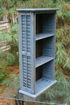 These are way too adorable! This wonderful bookcase or hanging wall shelf unit is made from reclaimed pine shutters. This one is in blue with a
