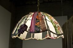 DIY lamp shade  (I'd pick prettier fabric :)