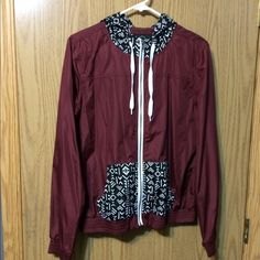 Maroon wind breaker sweatshirt Dark red/maroon colored windbreaker. Black and white Aztec print on the pockets and hood. Perfect condition, only wore it one time. Empyre Jackets & Coats