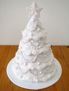"a ""white christmas"" themed christmas tree cake. elegant and bright for the holidays. Christmas Tree Cake, Christmas Cake Decorations, Christmas Sweets, Holiday Cakes, Noel Christmas, Christmas Goodies, Christmas Baking, White Christmas, Elegant Christmas"