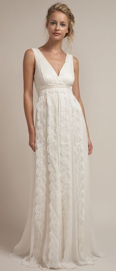 Lace Rustic Chic Wedding Dress. if it was just a tad shorter it would be a cute maxi dress...that may be an idea of what to do with old wedding dresses in this style. Get more use out of it :)