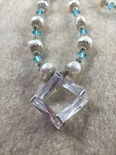 A personal favorite from my Etsy shop https://www.etsy.com/listing/267041726/freshwater-pearl-and-blue-swavorski