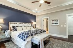 Master bedroom with light gray walls and dark blue accent wall behind tufted bed accent walls, Accent Wall Colors (Design Guide) Blue Master Bedroom, Romantic Master Bedroom, Master Bedroom Makeover, Master Bedroom Design, Bedroom Small, Dark Blue Bedroom Walls, Master Bathroom, Blue Walls, Bedroom With Ceiling Fan